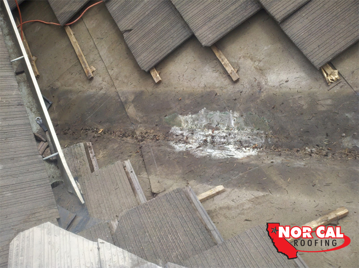 Nor-Cal Roofing - water damage under valley flashing on roof